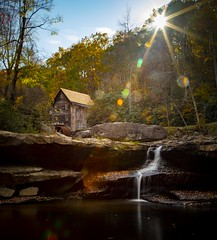 The eyes of the sun (Notkalvin) Tags: gladecreekgristmill mill babcockstatepark westvirginia notkalvin intothesun mikekline flare woodenstructure outdoors fall creek water longexposure notkalvinphotography