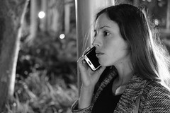 Tell me more (Michi and Juan) Tags: woman lady talking phone black white street face portrait cell fujifilm xpro2 xf 35mm f2 expression acros brickell miami florida sidewalk