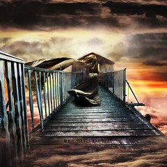 Thinking about what I call home... (Silvia Andreasi) Tags: silviaandreasi woman imagesbeyondmirror ruins goldenhour bridge misty mistiness fantasy fantastic clouds light flare imagination imaginary surrealism surrealmood hope horizon shortcut photomanipulation artphotography fineartphotography fabric dreamscape dreamy texture textured wood walk whimsical whimsy walking
