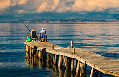 Fishing at Corfu (Gilbert Kuhnert) Tags: activiteit activiteiten activities activity aktivität aktivitäten angeln blau blauw blue cloud clouds coastalline coastline corfu eiland ellás fischen fishing geel gelb grece greece griechenland griekenland hellas insel island korfu kustlijn küstenlinie landscape landschaft landschap mediterranean menschen mensen middellandsezee mirror mirroring mittelmeer people reflectie reflection reflektion scenery spiegel spiegeling spiegelung steeg steg vissen weiss white wit wolk wolken yellow ελλάδα ελλάσ κέρκυρα