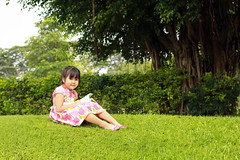 asain little girl reading a book in the park. (By Jan_) Tags: old summer nature girl grass animal female asian outside outdoors reading book photo stuffed education asia sitting child open little five space adorable literature story stuffedanimal thai learning imagination years homework schoolgirl studying telling enjoying textbook studious storytelling littlegirls pretending lifestyles childrenonly elementaryage childreadingbook