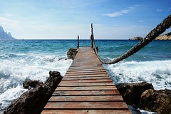 Ready to go? (M a u r i c e) Tags: wood blue light sea sky sunlight color colour beach rock canon spain rocks mediterranean waves horizon wave bluesky rope ibiza es 1022mm baleares balearic caladhort eos450d