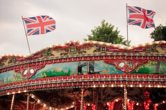 Union jack. (sarahbrust.) Tags: park uk london gardens jack lights flag mary union go round kensington carrousel