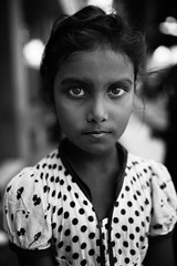 Eyes and pois (Giulio Magnifico) Tags: woman girl smile look closeup composition contrast children intense eyes shadows child emotion expression indian young citylife streetphotography streetportrait essence gaze curiosity glance pois genuine udine intrigued nikond800e