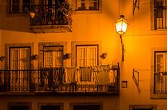 Lisbon by night (hjuengst) Tags: travel light orange portugal window lamp yellow night licht reisen streetlight nightshot nacht lisboa lisbon fenster hauptstadt lissabon laterne altstadt oldtown nachtaufnahme captital nikond7000