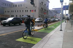 polk st. contraflow cycle track with bike traffic lights (citymaus) Tags: sf sanfrancisco light green bike cycling traffic market commute bikelane cycletrack polk marketst greenlane bikelanes contraflow sfbike cycleinfrastructure protectedbikelane