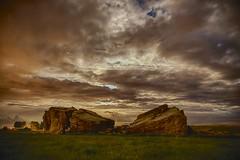 Behind the Big Rock (John Andersen (JPAndersen images)) Tags: longexposure night clouds fence alberta geology bigrock glacial erratic okotoks