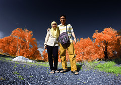 Me and my lovely wife  (living in infraRed colour.) (Kamaruz Zaman) Tags: canon colours colourful autumm canon7d canoninfrared canonir azamalwi autumninfrared autumminfrared autumnbyazamalwi samyangfisheyes