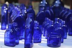 Blue Bottles (Read2me) Tags: she blue glass dof bottles bokeh many cye gamewinner brimfieldantiquesfair flickrchallengewinner thechallengefactory yourock1st storybookotr pregamewinner challengeclubwinner