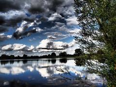 Stormy Weather (davepickettphotographer) Tags: summer lake water clouds reflections evening pond dramatic olympus drama cambridgeshire huntingdon em1 olympuscamera huntingdonshire