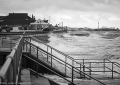 Storm hits Clacton 1 (Marc Jacobs Photography) Tags: sea white kite storm black beach monochrome rain weather lens lumix photography pier seaside waves force wind g hurricane strangers stormy olympus x gale panasonic shore f marc windsurfing 28 hits jacobs essex clacton f28 omd bertha em1 vario 35100mm