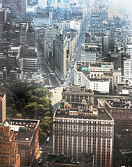Cityscape view seen from the observation deck of the Empire State Building in New York City, New York, August 1982 (alcomike43) Tags: park street old city newyorkcity newyork color classic architecture vintage buildings photo rooftops structures slide historic photograph empirestatebuilding roads fifthavenue flatironbuilding venicles