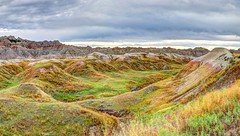 Badlands, SD - August 2014 - 45 - HDR-002 (mastrfshrmn) Tags: road blue red summer sky orange storm mountains green fall yellow rock clouds canon dessert rainbow colorful desert dunes august hills badlands prairie peaks plains hdr formations 2014 70d