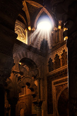 Rays of light in the MosqueCathedral of Crdoba (Ruben Moreno Montoliu) Tags: light sun detail building church window architecture contrast dark spain catholic ray arch cathedral muslim decoration arches mosque ceiling arabic dome cordoba rays andalusia canoneos450d canonefs1855mmf3556is mosquecathedral mosquecathedralofcrdoba