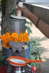 Freshly Squeezed Marigold (Mayank Austen Soofi) Tags: food flower fruit hand arm drink juice delhi fresh vendor marigold walla