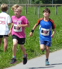 Running together 5 (Cavabienmerci) Tags: boy sports boys sport youth race children schweiz switzerland  child suisse earring running run course runners earrings pied runner 2014 lufer mnsingen lauf coureur coureurs louf mnsiger