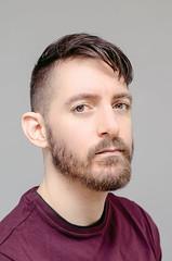 (Damien Cox) Tags: selfportrait autorretrato portrait self i ego myself me moi beard stubble scruff nikon male man masculine damiencoxcouk damiencox face eyes plum tshirt uk