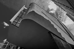 (McQuaide Photography) Tags: city blackandwhite bw holland building haarlem netherlands monochrome architecture canon eos blackwhite europe nederland wideangle dslr modernistarchitecture centrum modernarchitecture stad gebouw uwa wideanglelens ultrawideangle 100d 1018mm mcquaidephotography