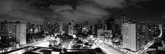 Praa Rui Barbosa (cassijones.) Tags: brazil sky blackandwhite bw paran monochrome brasil night clouds buildings square lights downtown panoramic curitiba cassijones cassijonescom cassianorosario