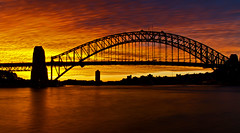 Iconic winter sunset over Sydney Icon (loobyloo55) Tags: bridge blue orange water yellow reflections purple sydney australia harbourbridge