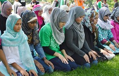 Line of young Muslim women wearing hijabs, kneeling in prayer. (desrowVISUALS.com) Tags: march israel peace palestine muslim islam faith rally prayer religion praying protest middleeast hijab demonstration antiwar muslims gaza islamic palestinian protestmarch antiwardemonstration muslimwomen politicalrally politicalmarch palestinianprotest palestiniandemonstration