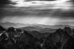 Hazy Layers (Gabriel Tompkins) Tags: park trees sky blackandwhite bw usa sunlight plant mountains tree nature monochrome clouds contrast america forest skyscape landscape outside outdoors blackwhite washington nationalpark haze nikon paradise day ray moody shadows view cloudy hiking horizon scenic dramatic overcast hike hills evergreen valley mountrainier mountrainiernationalpark pacificnorthwest vista rays nikkor hazy dslr sunrays washingtonstate overlook viewpoint pnw cloudscape crepuscularrays 18105 godrays lightbeam 2011 d90 18105mm nikond90 18105mmf3556gvr tronam gabrieltompkins tronamcom