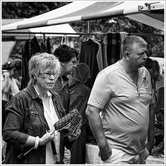 Don't need it, after all... (John Riper) Tags: street bw woman man netherlands face look umbrella john hair square photography market zwartwit bazaar flea voorburg zw vierkant johnr straatfotografie riper johnriper