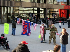 Big Flag Meets Big Gun (PPWIII) Tags: grandrapids march 4 trump pence calder plaza militia camo guns semi auto rifle pistols