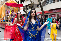 Patience and Divinity (The Whisperer of the Shadows) Tags: bollywood indian india mujer chica woman girl red rojo blue azul carnival carvanal parade desfile costume disfraz contrast contraste ciudadreal urban urbana geotagged