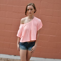 Model in Spring (PhotoAmateur1) Tags: pink blue red woman brown brick beautiful beauty face wall shirt hair outside outdoors arms legs top gorgeous jeans tummy denim shorts brunette lovely daisydukes