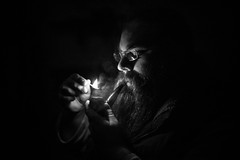 293. Chessmaster (prenetic) Tags: portrait night dark beard fire glasses pipe danny match tobacco