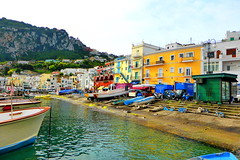 The colours of the Isle of Capri (peggyhr) Tags: blue red italy white green yellow boats capri waterfront cliffs tees marinagrande blueribbonwinner 25faves peggyhr p1130219a