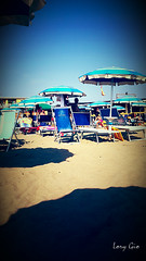 In Spiaggia (.lory.) Tags: sea sun sunlight beach water colors weather umbrella mare colore shadows ombra ombre cielo sole paestum acqua azzurro colori ombrelloni spiaggia lido lidolago