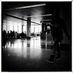 Waiting at ORD (swanksalot) Tags: hipstamatic johnslens aobwfilm bw blackandwhite ord o'hare airport availablelight explored blogged urbanseens
