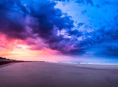 Last Light at Bacton Beach [explored] (rkphotographer) Tags: uk blue light sunset red panorama orange beach clouds landscape sand nikon purple tide low norfolk nikkor groyne f4 vr 1635 bacton beacheslandscapes