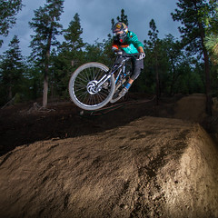 Big Bear Mountain Resorts Bike Park at Snow Summit in Big Bear Lake, California. Catching Air on a rainy day.