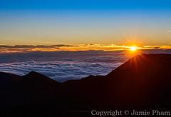 Sunrise from the summit of Haleakala Volcano in Maui, Hawaii. (Jampham) Tags: morning sunset sky sun clouds sunrise dawn golden high colorful glow bright dramatic peak maui stunning summit sunburst glowing dawning elevation sunflare abovetheclouds sunstar haleakalanationalpark haleakalavolcano