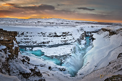g u l l f o s s  21277 (Philip Esterle) Tags: gullfoss sunrise winter dawn pentaxk3 landscapes panorama clouds skyscapes streams landscapephotography hdr rocks canyons waterscapes suðerland waterfalls rivers scenic snow philipesterle iceland skies hvítáriver naturephotography ice goldencircle waterfall canyon canyonscapes fingolfinphoto is