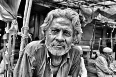 I met this man during my last day in Kolkata, he has one of the most interesting faces I have ever seen (paola ambrosecchia) Tags: india kolkata street blackandwhite monochrome biancoenero beautiful light shadow contrast eyes face portrait streetphotography amazing