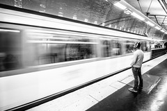 the hurried & the cool (RuinOfDecay!) Tags: ruinofdecay canoneos60d canon 1018mm paris france europe headphones metro traffic ubahn train zug sw bw monochrome schwarz weis man mann passenger street streetphotography strasenfotografie blurred speed geschwindigkeit