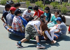 Regent Park Grand Opening (grecomic) Tags: park toronto playground children play candid roundabout merrygoround grandopening multiculturalism regentpark topwyds