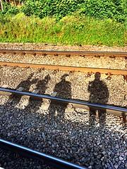 Waiting on the Platform (Deydodoe) Tags: life street uk shadow people lines station silhouette mobile train track candid platform tracks streetphotography rail railway line commute commuter commuting commuters stalbans iphone selfie 2014 mobilephotography deydodoe