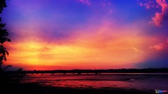 Sunset Hues (DJ DeeVise) Tags: sunset sky sun water silhouette clouds river warm riverside vivid setting hue