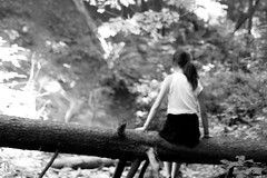 the girl and the fallen tree. (anthonyyuen99) Tags: park trees blackandwhite bw white black tree nature forest hair photography log emma fallen stump fallentree ravin photog ronmclean