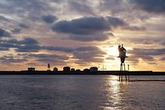 Kya (mrjensgreen) Tags: sunset sea lighthouse water norway beacon