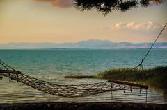 Exhale (Melissa Maples) Tags: summer lake mountains beach water turkey hotel evening nikon asia dusk trkiye hammock nikkor vr afs  18200mm  f3556g atapark  beyehir 18200mmf3556g d5100