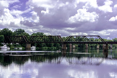 Train Bridge over the Savannah River (DancingTerrapin) Tags: bridge sky reflection water river boat rust downtown bridges boating augusta waterway transporation savannahriver augustaga downtownaugusta augustageorgia cloudsreflectiontrain