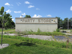 Abandoned party store but do not get confused about what it used to be. (Tim Kiser) Tags: 2014 20140724 daucus daucuscarota elmsroad elmsandmiller flintmetropolitanarea geneseecounty geneseecountymichigan img0769 july july2014 michigan michiganpartystore midmichigan millerroad millerandelms swartzcreek swartzcreekmichigan swartzcreekpartystore abandonedbuilding abandonedbusiness allcaps bodega building businessfailure businesssign cstore centralmichigan closedbusiness conveniencestore eastcentralmichigan failedbusiness formerbusiness gravel liquorstore mostlysunny mowed mowedgrass ornamentaltree outofbusiness overgrownarea overgrownparkinglot overgrownpavement partystore partystoresign paved pavement queenanneslace sign suburbanflint weeds whitegravel wildcarrot wildflowers youngtree