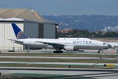 N216UA (IndiaEcho) Tags: california usa tom canon airplane eos los airport angeles aviation united aeroplane international civil bradley boeing lax airliner airfield 777200 klax n216ua 1000d
