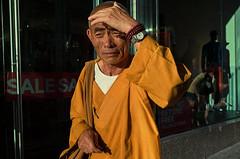 Endless Wheel of the Flesh (Giovanni Savino Photography) Tags: street orange newyork streetphotography streetportrait bhuddist bhuddistmonk newyorkstreetphotography magneticart summerstreets giovannisavino bhuddistinthesun
